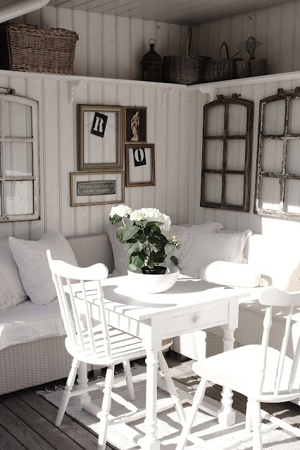 . Old window's and picture frames as art work on walls. love this