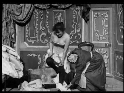 """After the Ball (1897) - Georges Méliès   Considered the 1st """"Adult"""" movie, After the Ball features a maid assisting a woman (Jeanne d'Alcy, who would later become the wife of Melies)."""