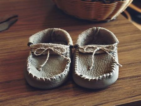 DIY leather moccasins.  These are one-piece Plains-Style.  Neat for home school or scout craft and sort of fun to make for a little one!