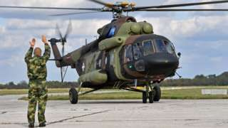 Image copyright                  AFP                  Image caption                                      Serbian transport helicopter: the air force will train with Russian paratroops this week near Belgrade                                Nato is holding a civil emergency exercise in Montenegro while neighbouring Serbia prepares for joint training with 150 Russi