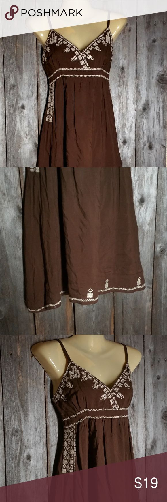 Mine Dress Top Brown Embroidered Boho Sundress Mine Women's Dress Top Size M Brown Embroidered Boho Peasant Sundress Mini Gently used Cotton & rayon Adjustable straps Unlined Smocked back Approx bust 34 - 38 and length from top of shoulder to hem 34 mine Dresses Mini