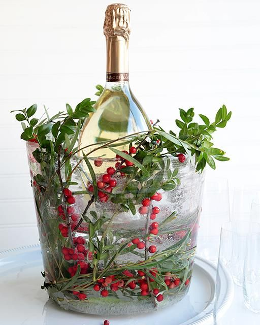 There's nothing more festive than this magical ice bucket! I used the clippings leftover from a holiday wreath I made. I can tell you that the guests at my holiday party were stunned! With this on the table you don't even need a centerpiece!