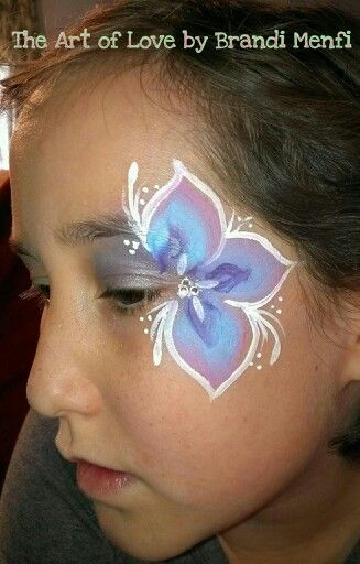 Quick & easy flower eye face painting. Put a metallic background to match the flower color before applying the one stroke flower.