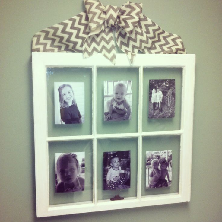 Old window frame and burlap bow. I need to paint my window yellow and add the knobs!