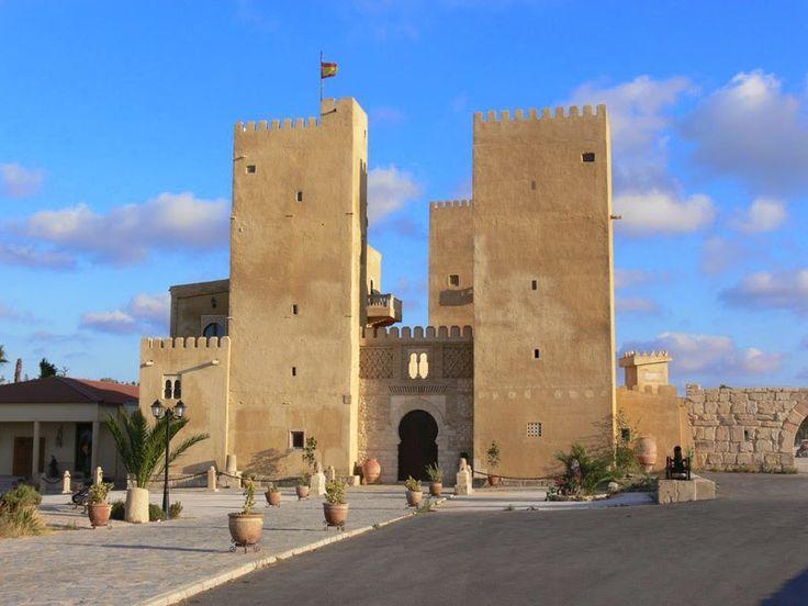 """CASTLES OF SPAIN - Castillo de Conesa, San Miguel de Salinas, Alicante. Sobre el siglo XIlos árabes establecieron en este lugar una alquería con un importante horno para la fabricación de cal, también construyeron una pequeña fortificación asociada a la alquería (hoy en dia en estado ruinoso). Muy cerca se encuentra lo que llaman el Castillo de Conesa, que es en realidad un falso castillo nazarí, construido como complejo turístico - hotelero, es un """"sucedáneo de alcazaba árabe""""."""