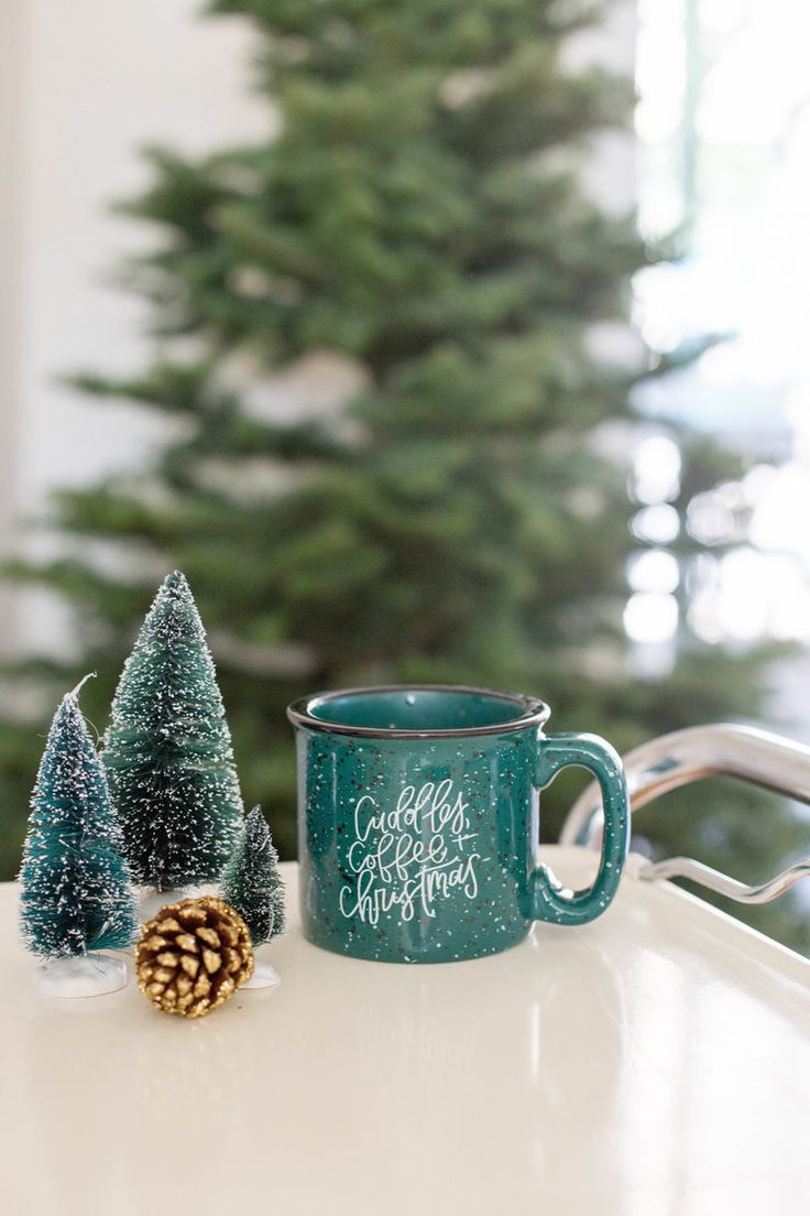 """""""Coffee, Cuddles, and Christmas"""" green Ceramic camper mug.This camper ceramic mug is for the Christmas lover and coffee fiend! She will wake up every morning excited to grab this mug from the cabinet; and even more excited for Christmas morning! If you countdown the days to Christmas starting December 26th, this is the one for you! This hand lettered mug is part of the Rachel Allene Christmas Collection. It is perfect for cold mornings cuddled up by the fire with Christmas music playing."""