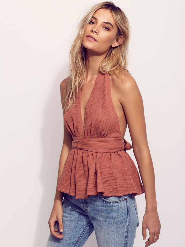 Nadja Halter Top | Made in New York, this halter top features an airy fabrication and sultry plunging neckline with open back. Wrap style closure with adjustable tie at the waist makes for an easy, effortless fit.