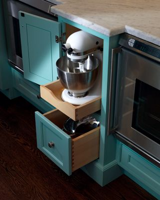 Plain & Fancy - Cool Turquoise Cabinetry designed for storing appliances in English-inspired Traditional Kitchen