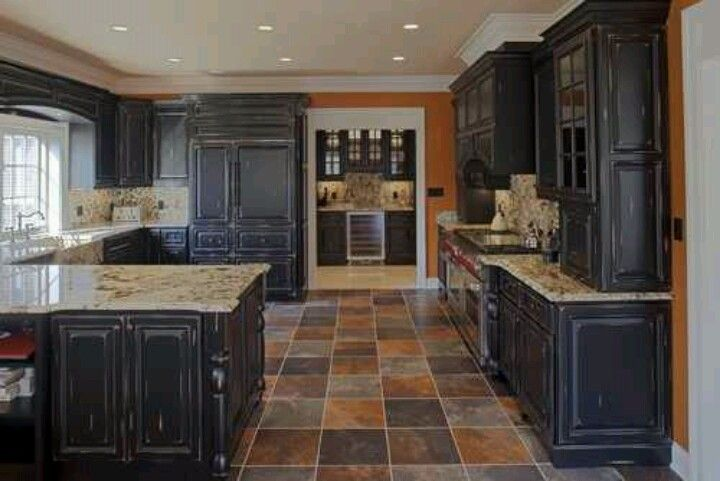 These dark cabinets with the colored slate floor are for Dark tile kitchen floor