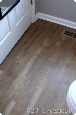 Allure water-resistant flooring from Home Depot -- 320 Sycamore used in their bathroom and it might be a good alternative for ours because it can go right over the linoleum...