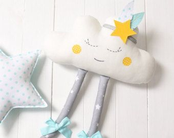 This sweet sleeping cloud is an adorable gift for baby shower and also for nursery or kids room decoration.  The cloud is made of cotton fabrics, has felt cheeks, cute bows and removable warbonnet. It's firmly stuffed with non-allergenic polyester fiber. Eyes and mouth are carefully hand embroidered. Measures approximately : 46cm x 37cm (considering the legs) 18 x 14,5  The cloud can be made to order in the colors and patterns of your choice :)  Thank you for looking