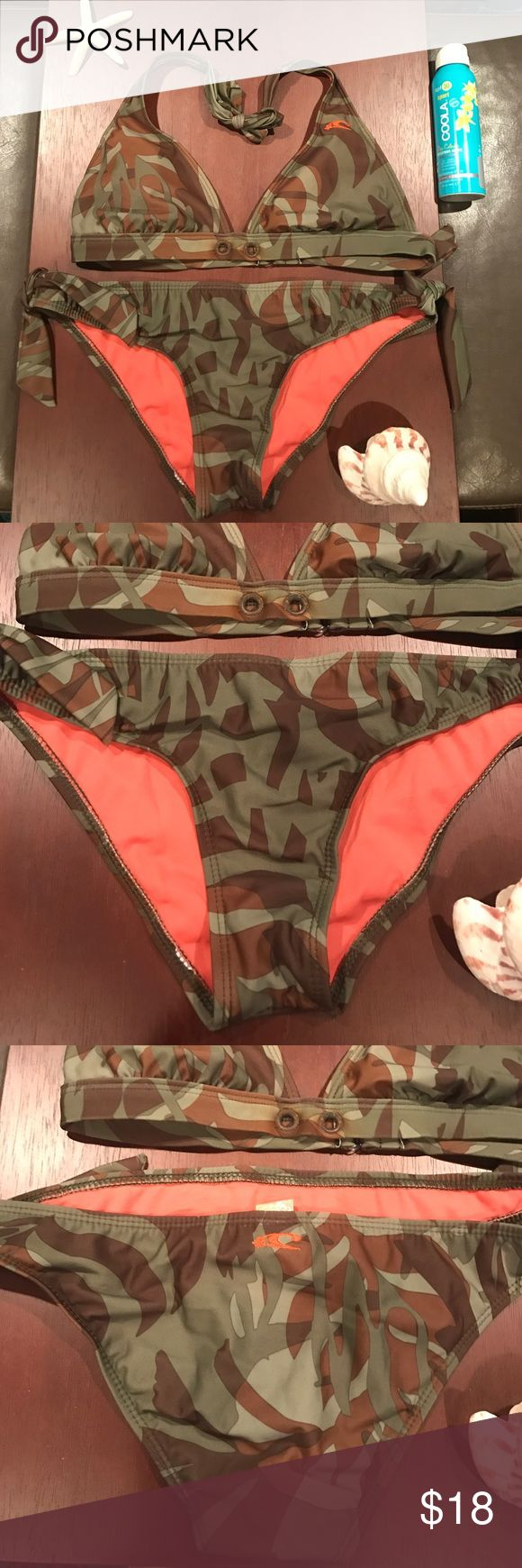 [O'Neill] Camo Bikini Great used condition. Size medium, O'Neill. The buttons show a little wear (in photos) otherwise perfect. Bundle to save - posted a lot of bikinis this size in my closet O'Neill Swim Bikinis