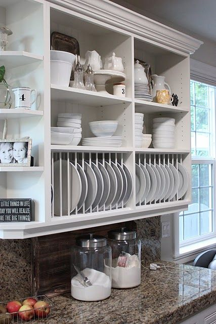 love the open shelves and the plate racks. Also the color of the countertops.