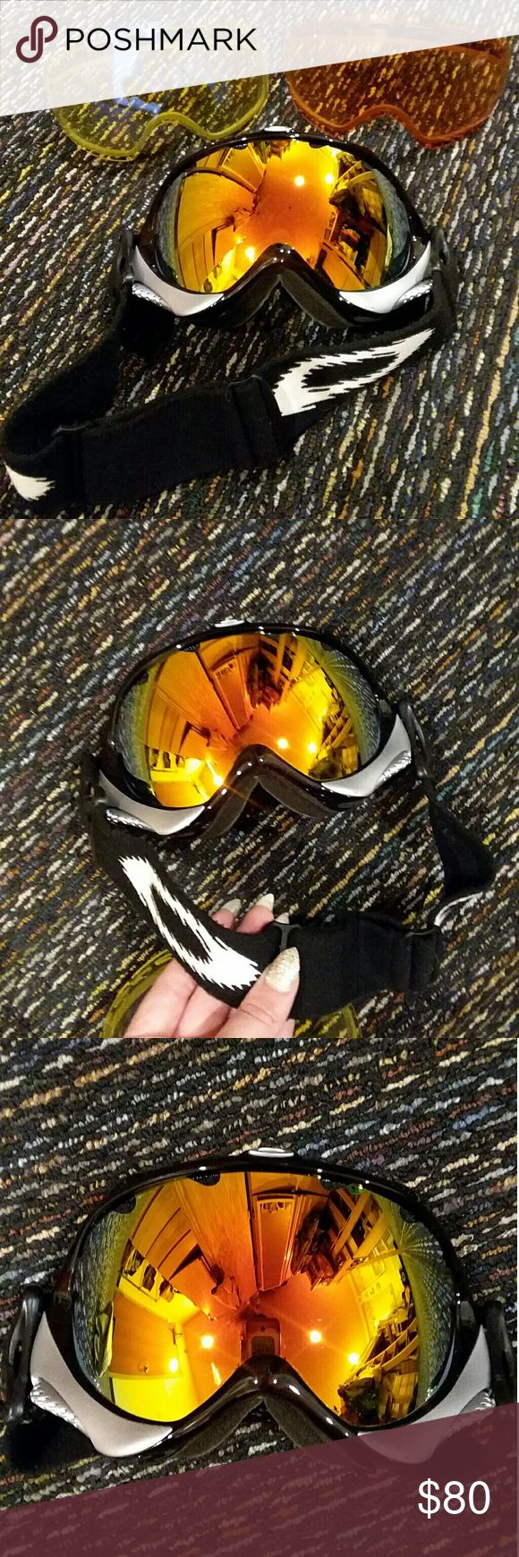Oakley Ski Goggles 100% Non Smoking & Pet Free Home.   Top 5% & ⭐⭐⭐⭐⭐ Seller. Shop with confidence :)  Feel free to like, follow, and share. Accepting  offers. Thanks for the love!   High-definition Unisex Oakley Ski Snowboard snowmobile Goggles. Safety and protection three pop in lenses for bluebird overcast day and night ski. fog free vents. Black frame w/ silver detail orange gold yellow to green shine chromatic mirrored adjustable elastic strap toggle sides works w/ helmet or hat. In…