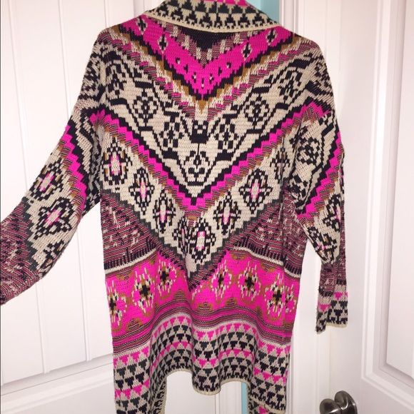 Pink cardigan tribal sweater size m/l brand new Pink cardigan tribal sweater size m/l brand new without tags, was given to me but it is a little large. Beautiful sweater! Sweaters Cardigans