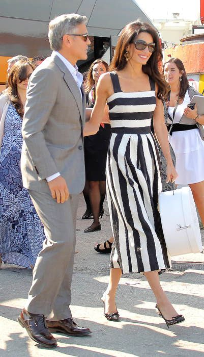 This silk Dolce & Gabana dress supposedly sold out already.  No wonder!  George Clooney and Amal Alamuddin #wedding