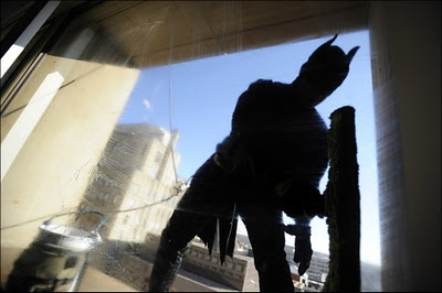Neo-Gotham: A window washer—J.R. Elkins of G Window Service—dressed as Batman works on the 8th floor of the Wells Fargo Building in Lincoln, Neb.