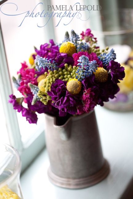 bridesmaids bouquet of stock, grape hyacinth, berzelia berries, and billy buttons | pamela leopold photography