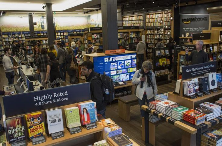 Customers shop inside Amazon Books in Seattle, Washington, on Tuesday, Nov. 3, 2015. The online retailer Amazon.com Inc. opened its first brick-and-mortar location in Seattle's upscale University Village mall. Photographer: Jasper Juinen/Bloomberg