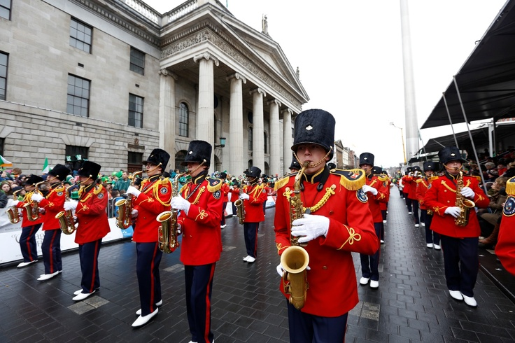 A marching band  passes by the Grandstand at the GPO
