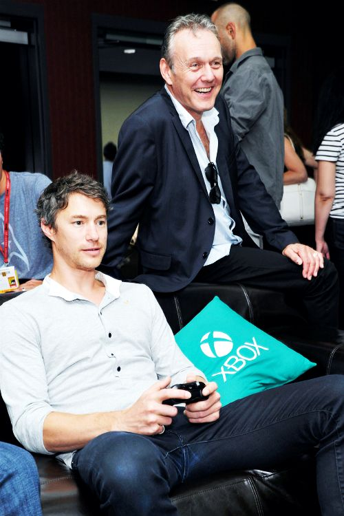Tom Wisdom and Anthony Stewart Head take a break from Comic-Con to play Xbox One Halo: The Master Chief Collection in the Microsoft VIP Lounge on July 25, 2014 in San Diego, California. [x]