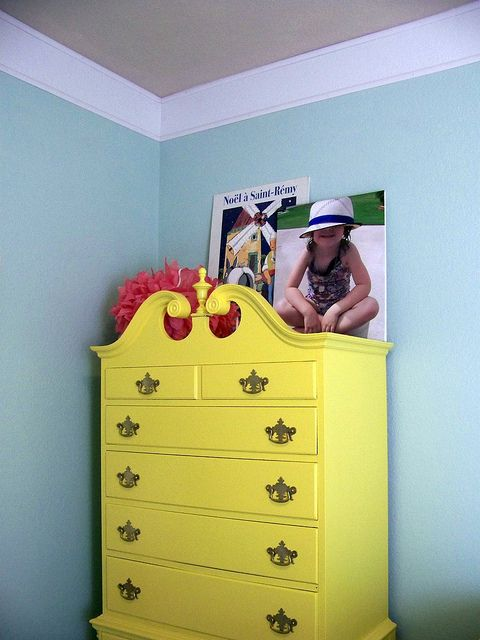 love this yellow dresser and the painted stripe to be crown molding