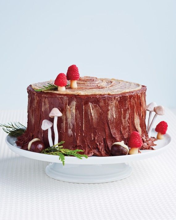 """Sugarplums aren't the only visions dancing around here. Serve dessert with a side of glamour at your holiday party or Christmas dinner -- or spoil Santa with a fat slice of cake on the mantel.We've reimagined the Yule log (or Buche de Noel) as a charming chestnut layer cake -- a """"Stump de Noel,"""" if you will."""