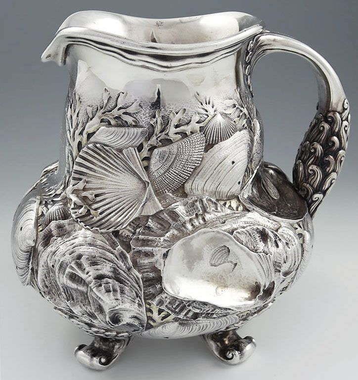 Rare Whiting antique sterling silver pitcher with chased three dimensional shells and ornate handle