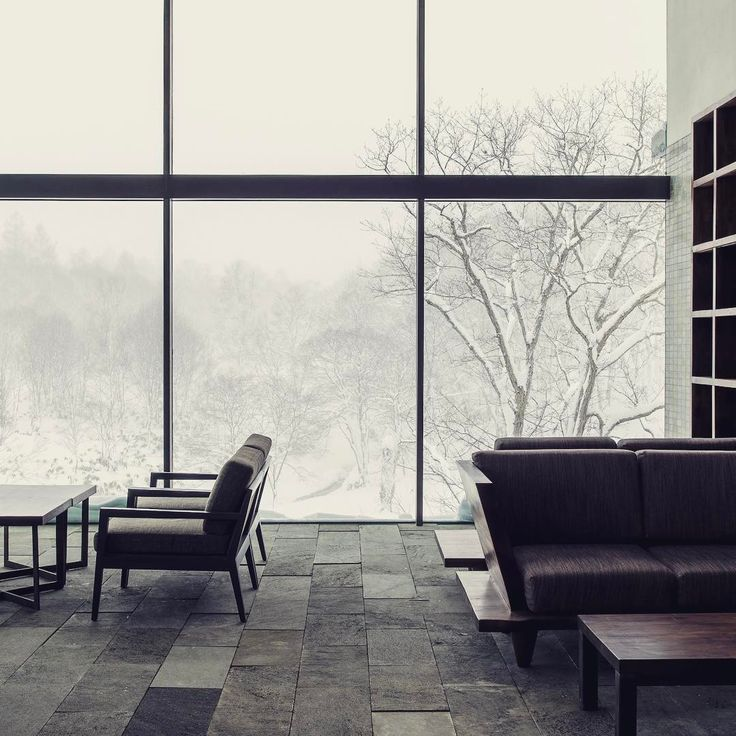 #roomwithaview the #livingroom @zaborin.ryokan #lounge #interiordesign #simpleisbest #naturalmaterials #lavastone #teak #bigwindows #naturallight #niseko #ryokan #hokkaido #visitjapan #zaborin  @zaborin.ryokan | zaborin.com