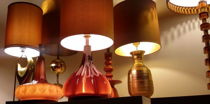 selection of amber and gold colored table lamps.