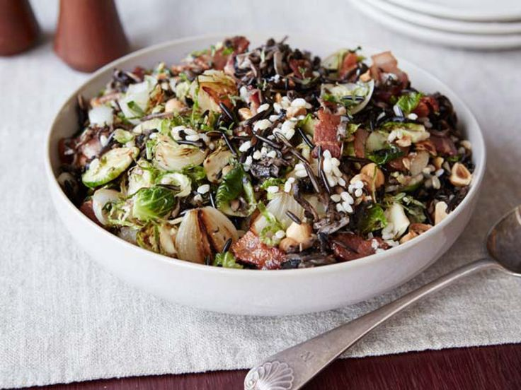 Christmas Stuffing with Bacon : Giada De Laurentiis' Christmas stuffing requires two types of rice as an alternative to bread. The pearl onions, Brussels sprouts, hazelnuts and chopped bacon add sweet and savory flavors.