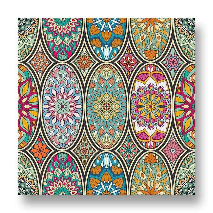 Oval Floral Pattern Canvas Print.  A stunning piece of wall art with an oval floral design.  This canvas print features multiple mandala inspired patterns with contrasting colours to create a compelling artwork.