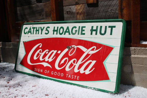 """Large Vintage Metal Coca Cola Sign $1499, with the Fish Tail Coca-Cola Logo. From Alabama this vintage Coke sign reads 'Cathy's Hoagie Hut, Coca-Cola, Sign of Good Taste' This Coke sign measures 72"""" wide by 36"""" tall by 2"""" thick. See our other vintage signs at https://www.etsy.com/shop/AmericanAntique"""