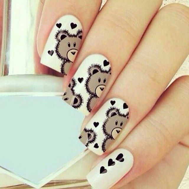 Awwwww... teddy bear nails... THAT IS SO CUTE<3