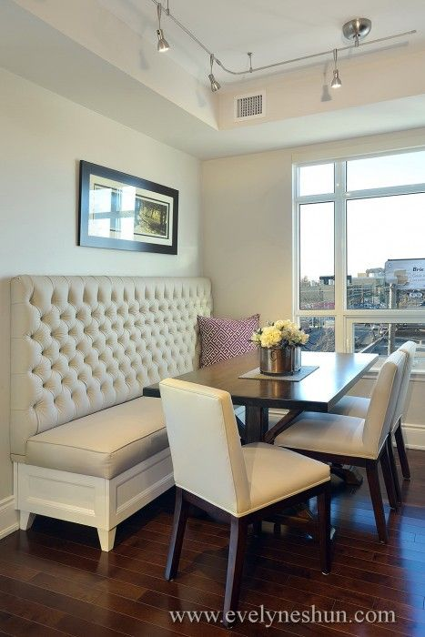 Built-in kitchen table - against the back wall, window on one side - love the tufted bench!