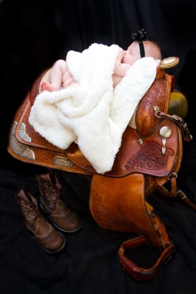 Country theme baby girl photos, Country western newborn photography, Baby poses in a saddle, country newborn photography, country newborn photo ideas