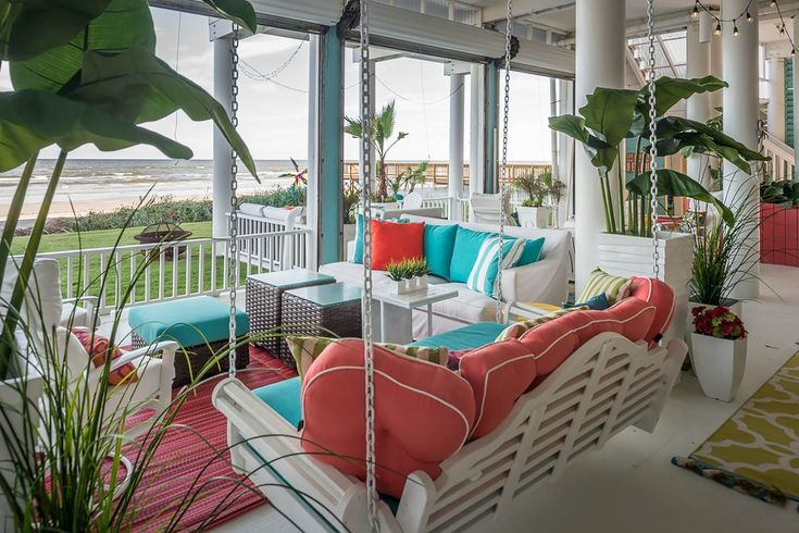 There's nothing better than kicking your feet up on a colorful porch, cold drink in hand, and watching the tide roll in.