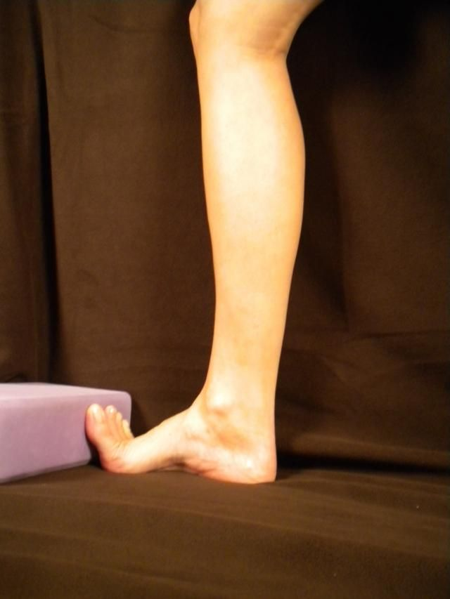 Flexor Hallicus Longus (FHL) Stretch: use wall to stretch your toes up vertically, keeping your heel on the floor, bend your knee slightly and push foward gently, until you comfortably feel the stretch in the bottom of your foot, the inside of your ankle, and the back of your calf.