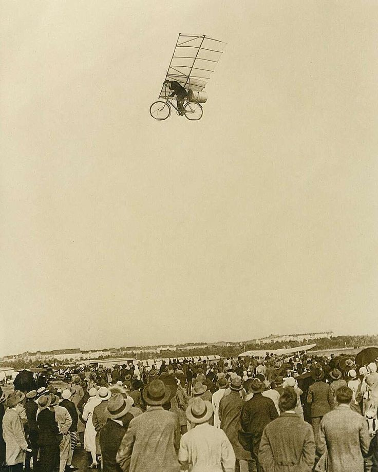 c. 1925. Crowd watching a flying bike.  Actually a photo montage created as April Fools' joke by a German newspaper.  #flyingbike #bicycle #flying #crowd #people #AprilFools #photomontage #German #newspaper #historicalpix by historicalpix