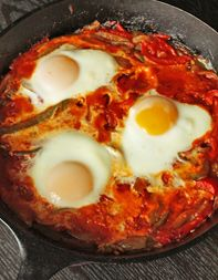 Sunrise, Sunset (Israeli tomato-and-baked-egg breakfast known as shakshuka. In Gorham's interpretation of the Middle Eastern classic, sweet peppers, onions and tomatoes mingle under runny baked eggs. This one-skillet meal is great to share at sunrise, but it will serve you well for supper, too.) Nummy!