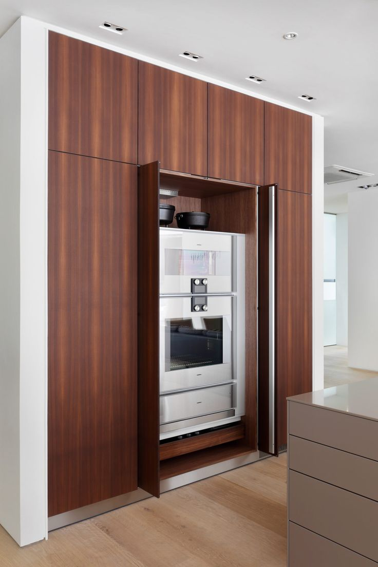bulthaup Clerkenwell display tall units in b3 smoked larch with gaggenau appliances