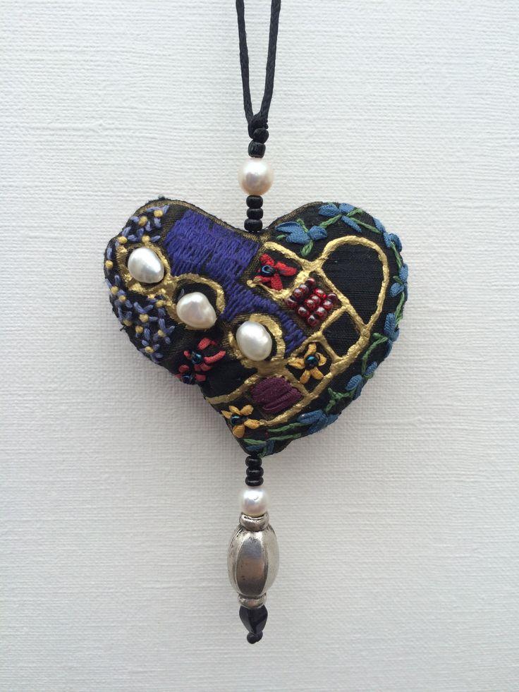 Silk heart pendants made by Klektik