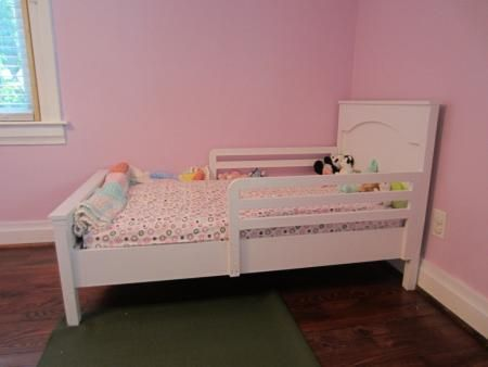 Toddler Farmhouse Bed | Do It Yourself Home Projects from Ana White  She added a side rail