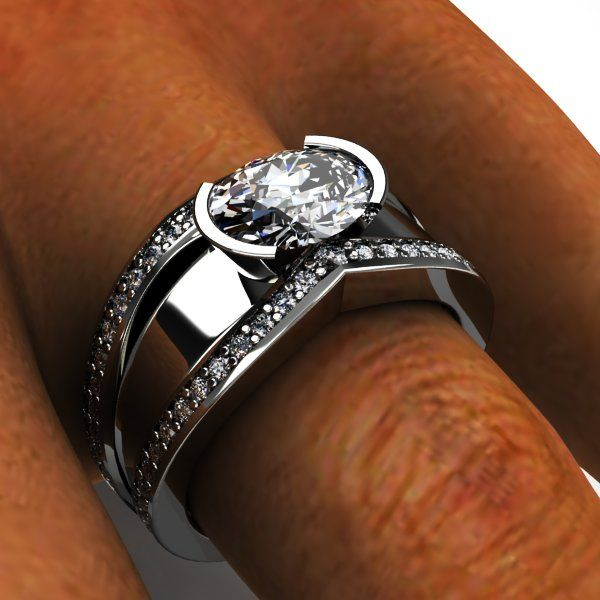 Palladium wide oval diamond and diamond side accent wedding band.   This couple were married for awhile and wanted to upgrade their wedding ring look. The original ring was a two piece thin diamond engagement and wedding band. They took the center oval and all of their small side diamonds and created this look.  Enjoy...