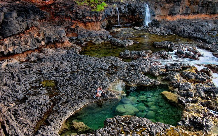 NORTH SHORE Secret Lava Pools Near Kilauea, 10 minute walk down the path to secret beach (aka Kauapea beach) 200ft below. To get there, turn right off the first (eastern) Kalihiwai Rd, then right on the first dirt road. Take the trail to the bottom and go Left for the secret lava pools. Also a great beach to snorkel at with long golden sand.