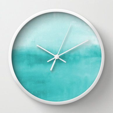 This piece was recently featured on Elle Decor & House Beautiful. Abstract wall clock in shades of turquoise/aqua/teal. ****Available in