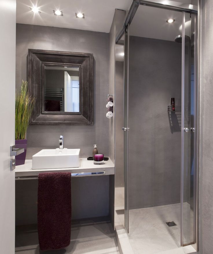 small bathroom. Shower has double opening sliding doors that move behind nib walls giving a much bigger opening