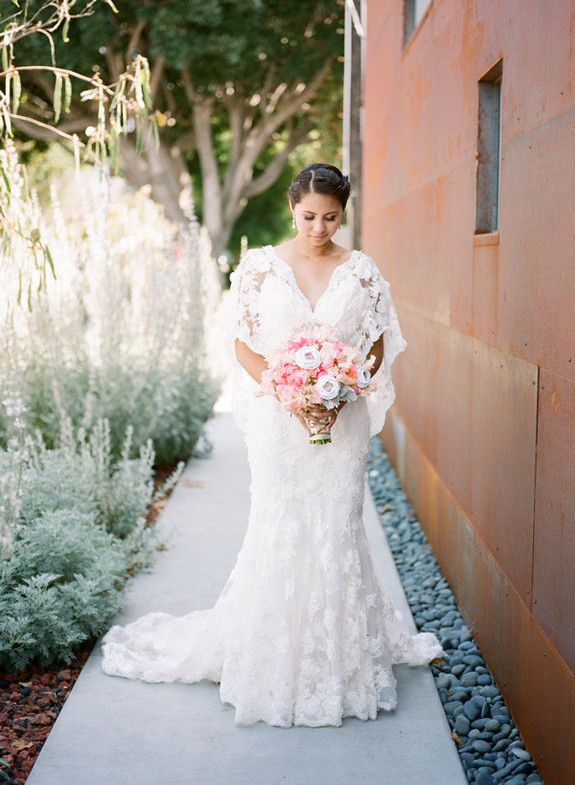 Whimsical Smog Shoppe wedding   In love with her lace gown - so different and beautiful