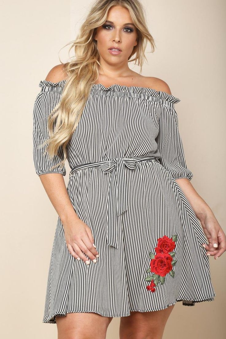 A plus size mini dress with an off-shoulder neckline and half sleeves. Features a belted waistline and a floral patch. Stripes all over and a flared hem.