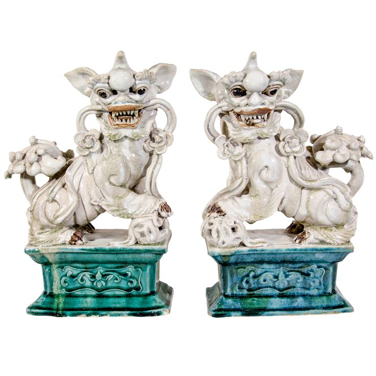 pair of 19c chinese foo dogs - china - late19c - LENGTH: 9 in. (23 cm) DEPTH: 4.25 in. (11 cm) HEIGHT: 13.25 in. (34 cm)